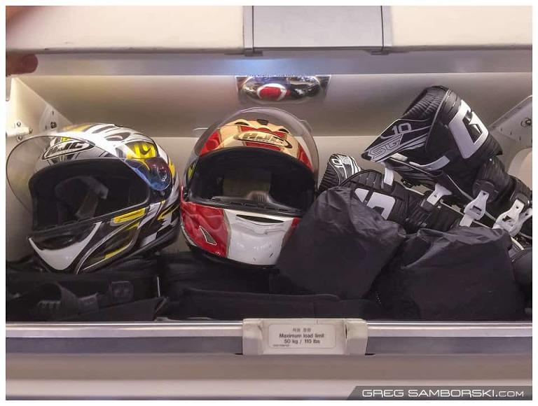 Motorcycle Gear in Overhead Bin