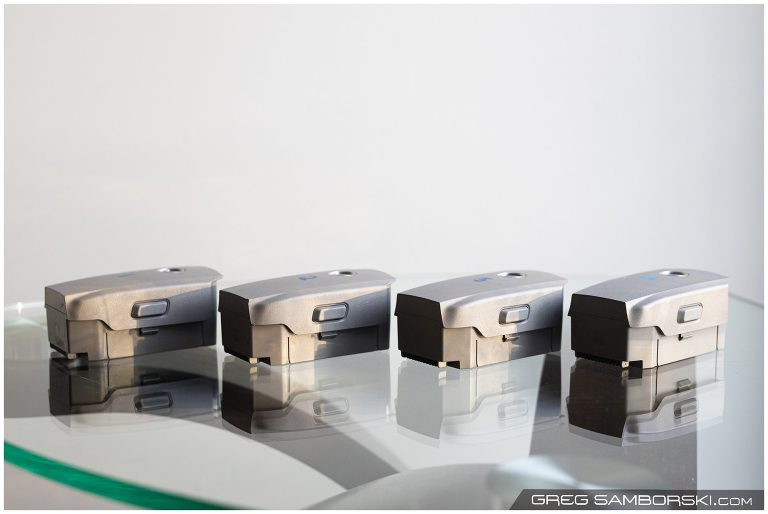 Four defective DJI Mavic 2 batteries on a table.